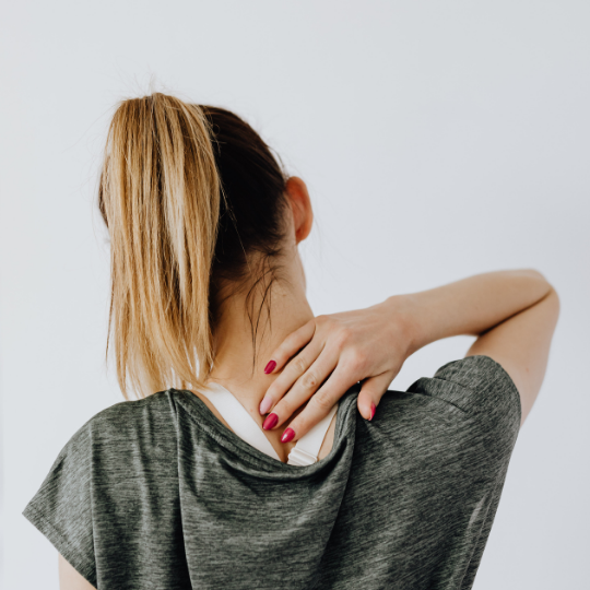 Woman with back turned rubbing back of neck. Do you know about the effects of trauma on the body? This is the place to learn from a skilled trauma therapist. Fill in the gaps and understand what is trauma.